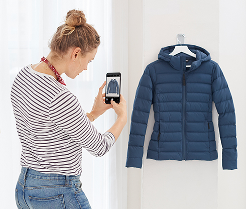 Woman taking pictures of a sweater