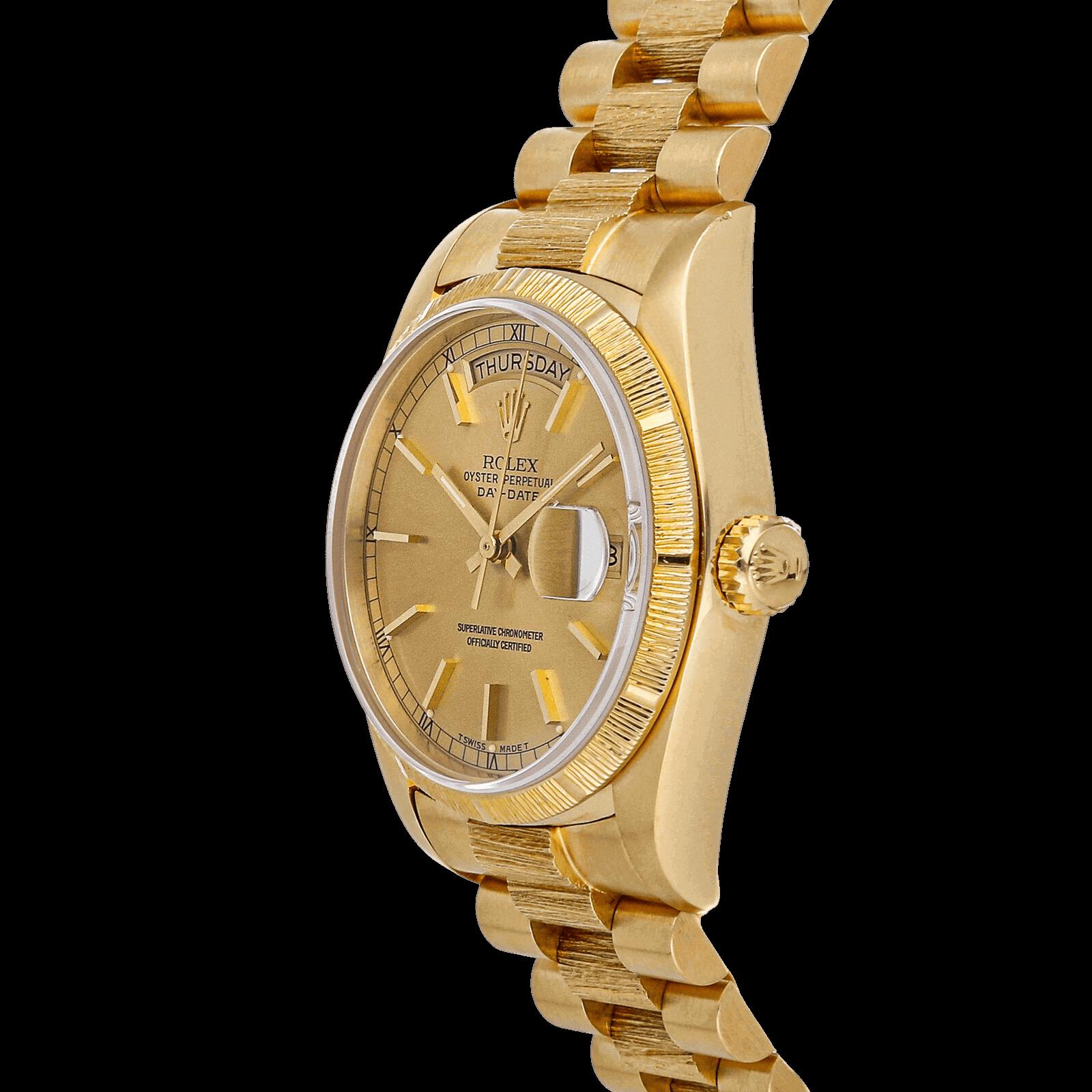 Watch with golden bracelet.