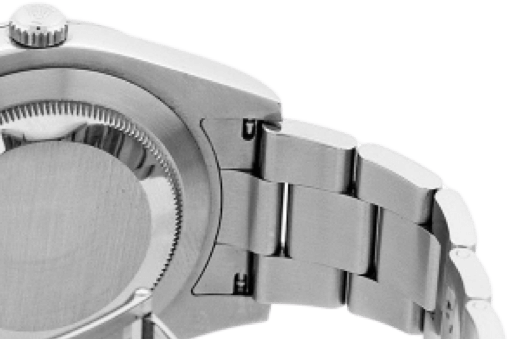 The back of a silver watch.