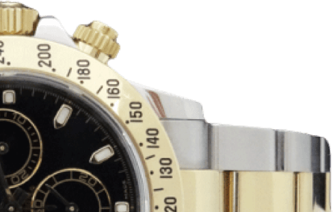 A gold and silver watch with a black face and gold accents.
