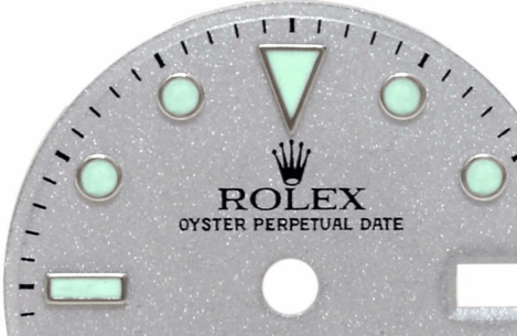 A gray Rolex watch face with light green accents.