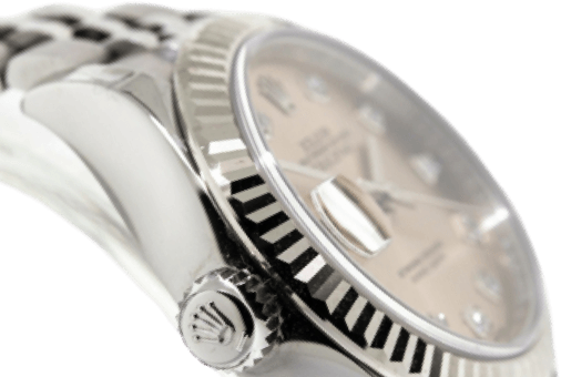 A silver watch with a light gold face and silver accents.