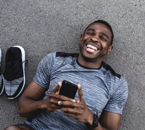 Man laughing with telephone