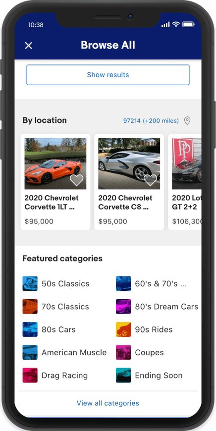 Phone screen capture: listings sorted by location, followed by a section titled 'Featured categories,' including '50s Classics,' 'American Muscle,' 'Ending Soon,' and more.