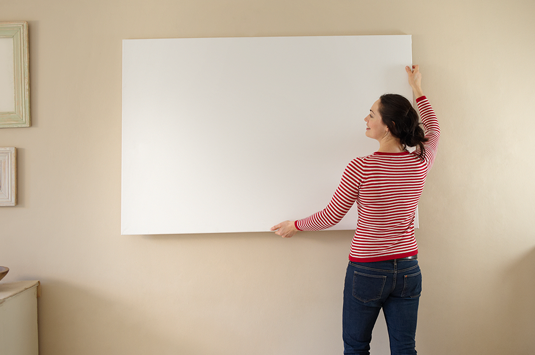 Woman hanging a whiteboard