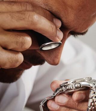 A man authenticates a watch