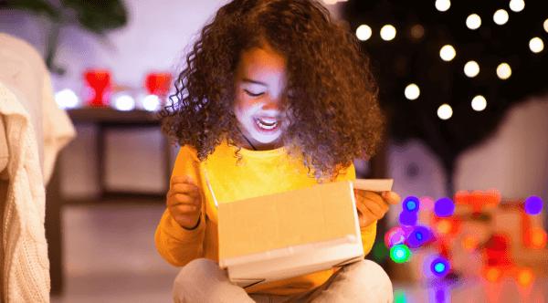girl opening box
